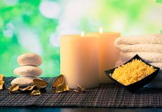 Spa massage border background with towel stacked, candles and sea salt Royalty Free Stock Photos
