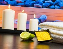 Spa massage border background with towel stacked candles sea salt and lime Royalty Free Stock Image