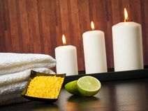 Spa massage border background with towel stacked candles and sea salt Royalty Free Stock Photo