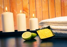 Spa massage border background with towel stacked candles and sea salt Royalty Free Stock Images