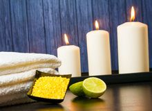 Spa massage border background with towel stacked candles sea salt and lime Stock Images