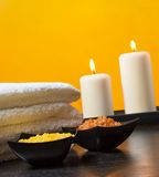 Spa massage border background with towel stacked.candles and sea salt Royalty Free Stock Image