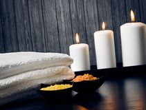 Spa massage border background with towel stacked.candles and sea salt Stock Images