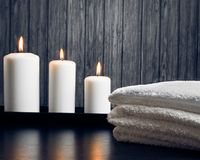 Spa massage border background with towel stacked and candles Royalty Free Stock Photos