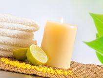 Spa massage border background with towel stacked and lime Stock Photography