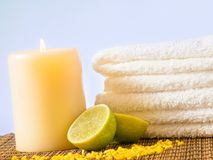 Spa massage border background with towel stacked and lime Stock Photo