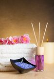 Spa massage border background with towel stacked, perfume diffuser and sea salt Stock Image