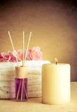 Spa massage border background with towel stacked, perfume diffuser Stock Images