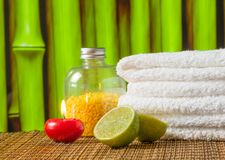 Spa massage border background with towel stacked red candle and lime Royalty Free Stock Photography