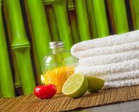 Spa massage border background with towel stacked red candle and lime Stock Image