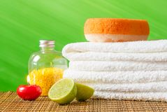 Spa massage border background with towel stacked,red candle and lime Royalty Free Stock Photo
