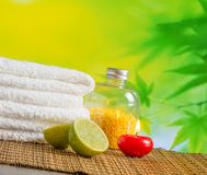 Spa massage border background with towel stacked,red candle and lime Stock Photography