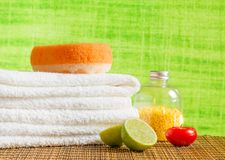 Spa massage border background with towel stacked,red candle and lime Royalty Free Stock Image