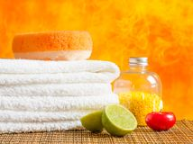 Spa massage border background with towel stacked,red candle and lime Royalty Free Stock Photography