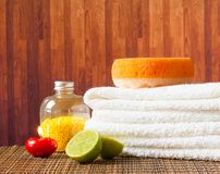 Spa massage border background with towel stacked red candle and lime Stock Images