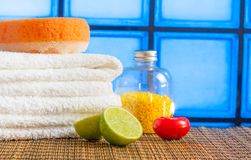 Spa massage border background with towel stacked red candle stone and lime Stock Image