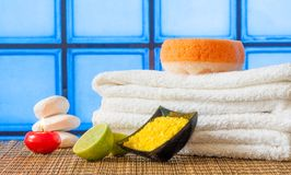 Spa massage border background with towel stacked red candle stone and lime Royalty Free Stock Image