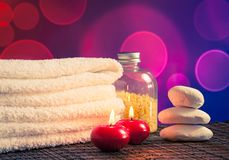 Spa massage border background with towel stacked,red candles and stone Stock Image