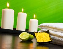 Spa massage border background with towel stacked sea salt candles and lime Stock Image