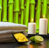 Spa massage border background with towel stacked sea salt candles and lime Stock Images