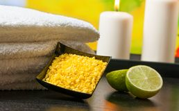 Spa massage border background with towel stacked sea salt candles and lime Royalty Free Stock Images