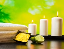 Spa massage border background with towel stacked sea salt candles and lime Stock Photo