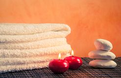 Spa massage border background with towel stacked stone and red candles Stock Photography
