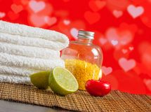 Spa massage border with towel stacked red candle and lime for valentine day Royalty Free Stock Images