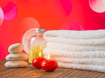 Spa massage border with towel stacked,red candles and stone for valentine day Stock Photos