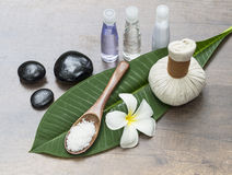 Spa massage compress balls, herbal ball on the leaves with rock spa, Thailand, select focus Stock Photography