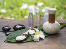 Spa massage compress balls, herbal ball on the leaves with rock spa, Thailand, select focus. Spa massage compress balls, herbal ball on the leaves with rock Royalty Free Stock Photo