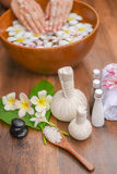 Spa massage compress balls, herbal ball on the wooden with tream. Ents spa , Thailand, soft and select focus Royalty Free Stock Photography