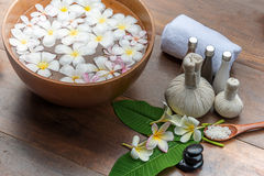 Spa massage compress balls, herbal ball on the wooden with tream. Ents spa , Thailand, soft and select focus Stock Photos
