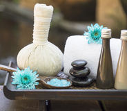 Spa massage compress balls, herbal ball on the wooden Stock Photo