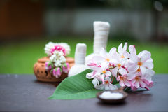 Spa massage compress balls, herbal ball on the wooden. With treaments spa , Thailand, select focus Stock Photos