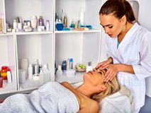 Spa and massage deals. Facial treatment for forty five year old woman spa salon. Royalty Free Stock Image