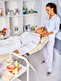 Spa and massage deals. Facial treatment for forty five year old woman spa salon. Stock Photo
