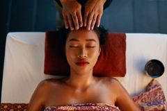 Spa Massage. Hands Massaging Woman Head At Thai Beauty Salon. Asian Girl Enjoying Massage Therapy. High Resolution stock photo