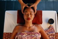 Spa Massage. Hands Massaging Woman Head At Thai Beauty Salon. Asian Girl Enjoying Massage Therapy. High Resolution royalty free stock photos