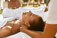 Spa Massage. Happy Woman Enjoying Relaxing Neck Body Massage. Royalty Free Stock Photo