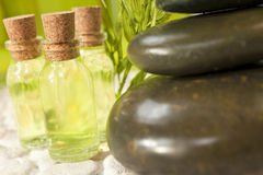 Spa Massage Hot Stones & Bottles Environment Royalty Free Stock Photos