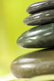 Spa Massage Hot Stones With Green Background stock images