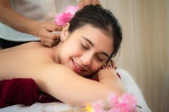 Spa Massage.  Masseur doing massage with treatment sugar scrub on Asian woman body in the Thai spa lifestyle, so relax and luxury. stock photo
