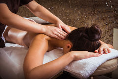 Spa, massage. Masseur doing massage on woman body in the spa salon royalty free stock photo