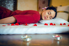 Spa, massage. Masseur doing massage on woman body in the spa salon. Bokeh blur stock images