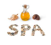 SPA. Massage oil and the composition of the word SPA shells Stock Images