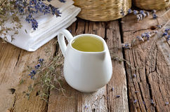 Spa massage oil. Spa massage herbal oil in a white jug stock photography