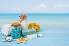 Spa massage products on wood over blurred blue sea background Stock Photos