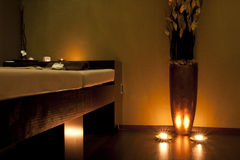 SPA massage room in gold royalty free stock photography
