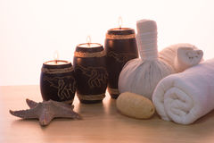 Spa Massage. Setting with rolled, towel, candlelight stock image
